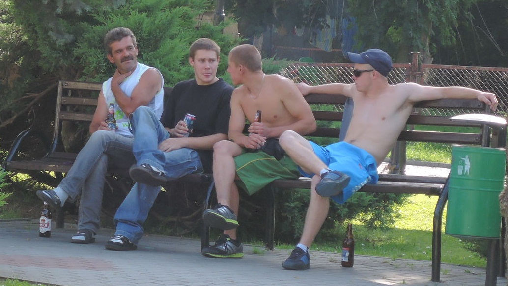 "Four blokes ""kurwing around"" in the park."