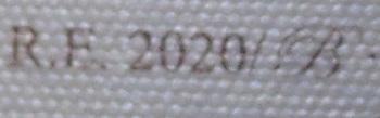 Detalle del número de registro. La B es apenas legible con lupa.